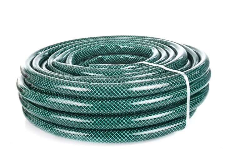 Garden hose in studio. Garden hose in front of white background stock images