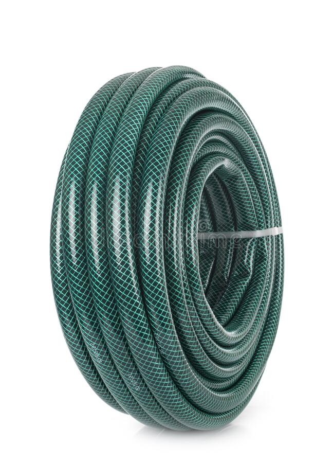 Garden hose in studio. Garden hose in front of white background royalty free stock photo