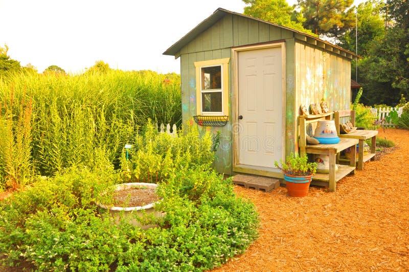 Garden house. A colorful garden house with green plants stock photos