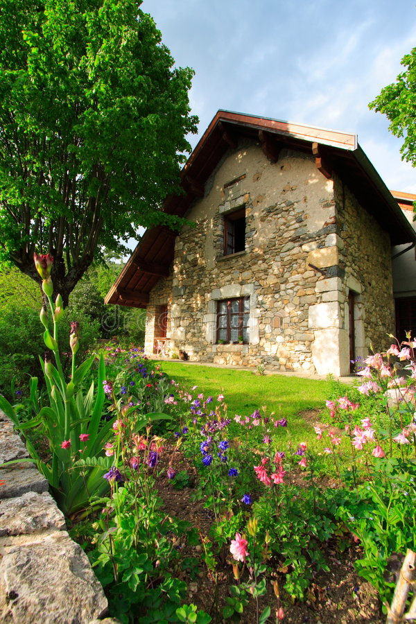 Garden and house. Garden in the the french countryside with an old typical house stock photos