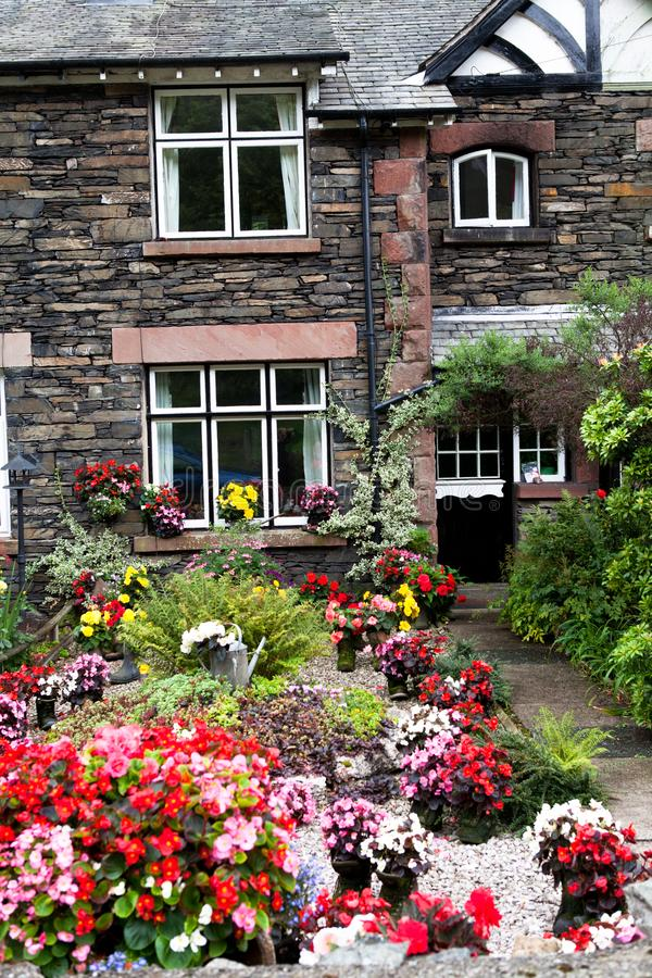 The garden before the house. The garden is full of the flowers before England style house.the yard is small but look nice.this is a guest house in York stock photo