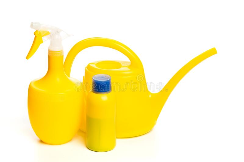 Garden or house plant supplyes sprayer, fertilizer  and watering can isolated on white background royalty free stock photography