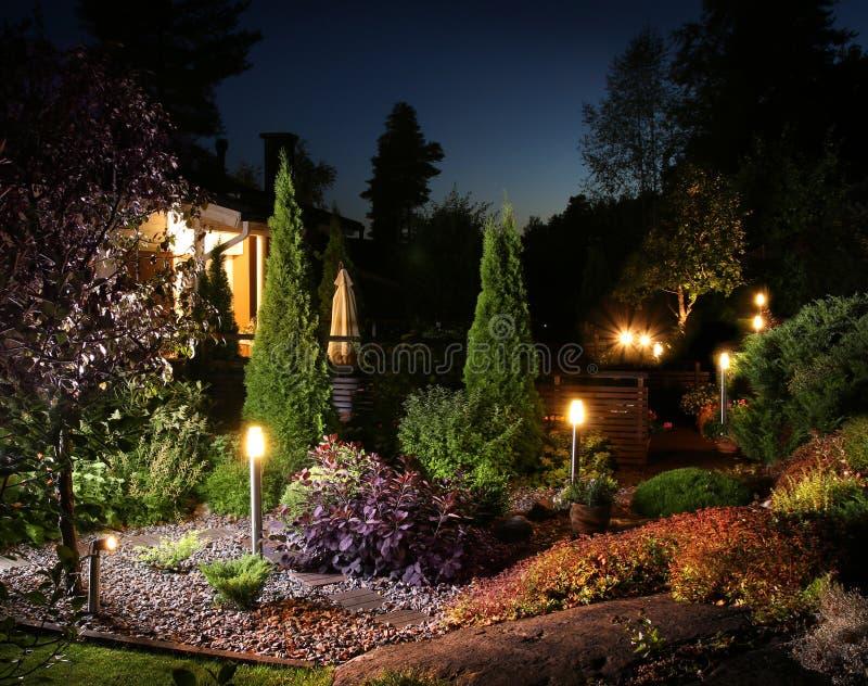 Garden illumination lights. Home garden illumination autumn evening lights patio royalty free stock photography