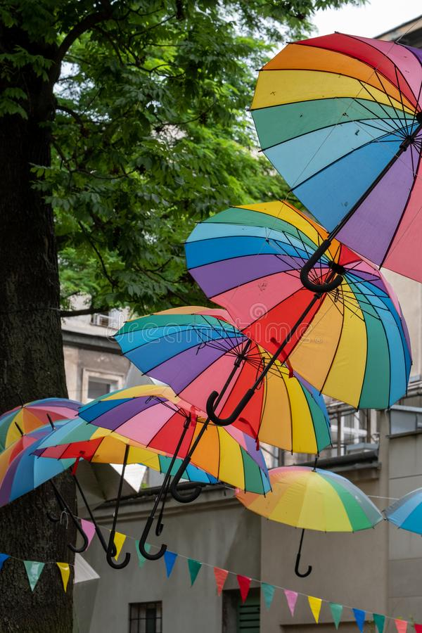 Garden of the Jewish Cultural Centre in Kazimierz, the historic Jewish quarter of Krakow, Poland with brightly coloured umbrellas. Garden of the Jewish Cultural stock images