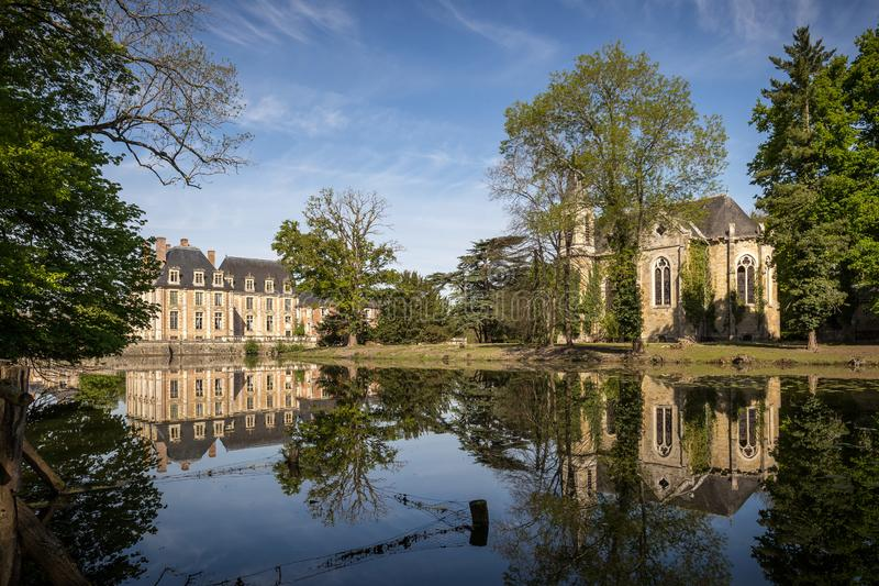 Garden, Lake And Chapel With Chateau-de-la-Ferte Saint-Aubin, France stock images