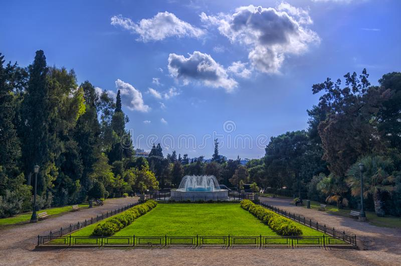 The garden with the marble fountain in front of the Zappeion Hall neo-classical building. Athens, Attica / Greece. The garden with the marble fountain in front royalty free stock images