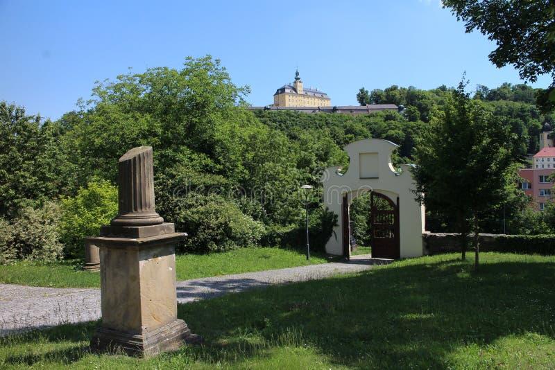 Garden near Chapel of St. Roch and Sebestian and Fulnek castle in background. Czech republic royalty free stock photo