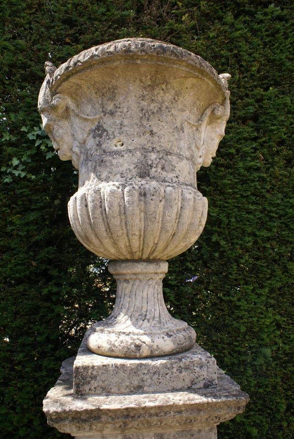 Garden ornament. Formal British garden ornament decoration of a sculptured urn on a pedestal, England royalty free stock images