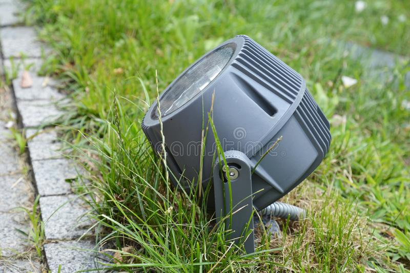 Garden outdoor lighting in the lawn grass. And pavement stock image