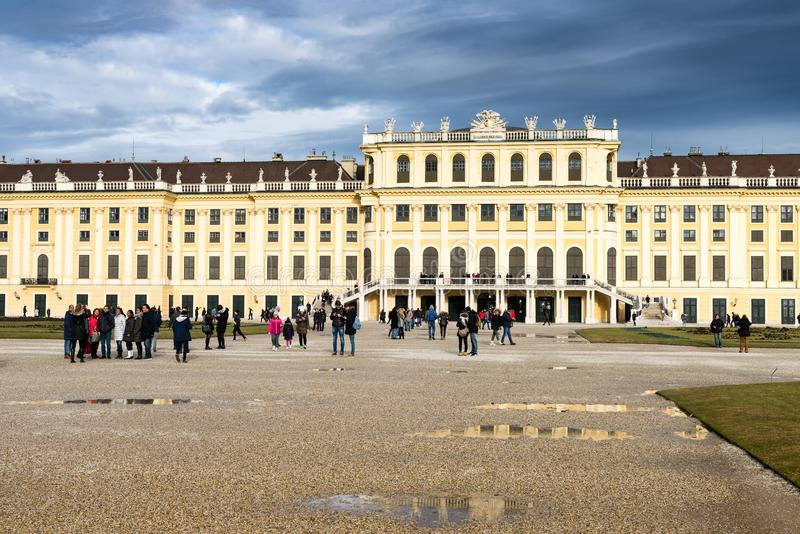 The garden in Shonbrunn palace, Vienna Wien, Austria, rainy day. The garden park in Shonbrunn Palace Wien in rainy day with small puddles and large groups of royalty free stock images