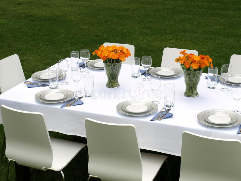 Garden party. Elegant laid table for a garden party royalty free stock image