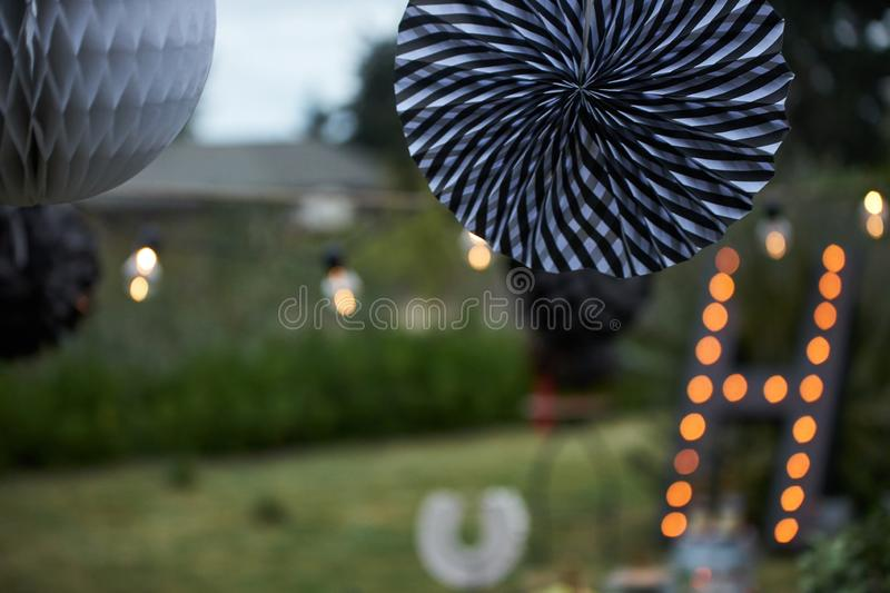 Garden party decoration. Hanging decorative christmas lights royalty free stock photos