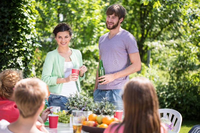 Garden party at summer time. Friends having garden party at summer time stock images