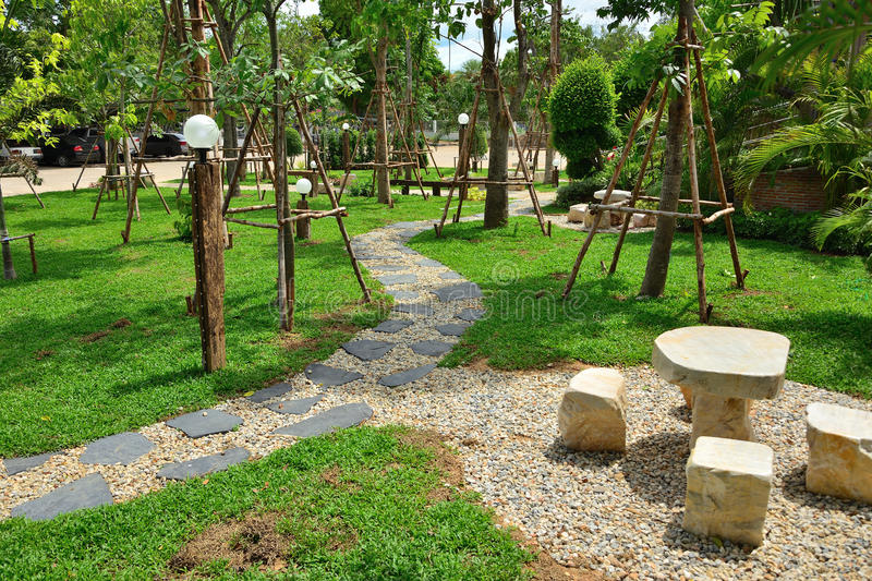 Garden path and grass field,. Garden path and grass field marble table stock photo