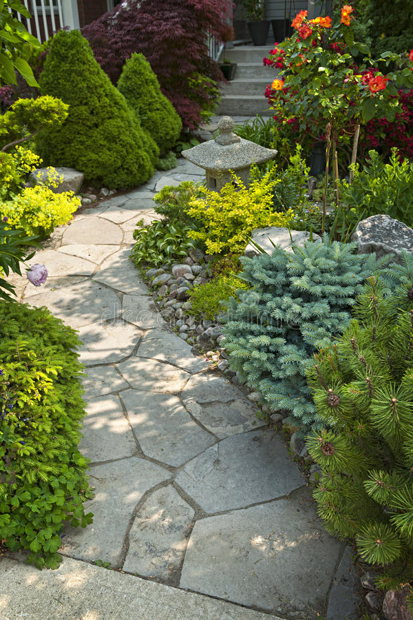 Garden path with stone landscaping royalty free stock photo