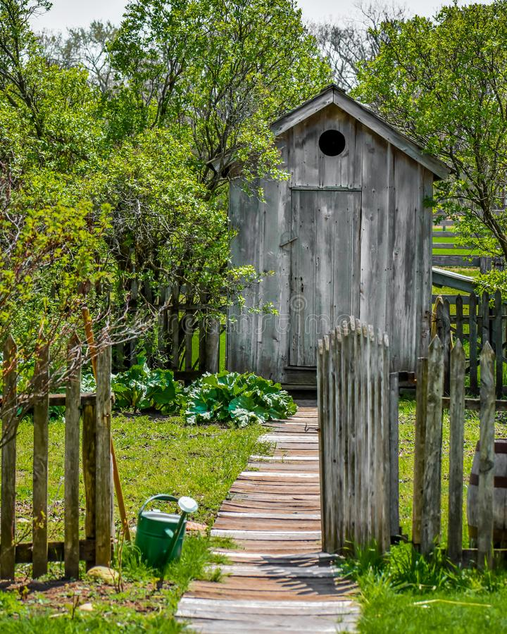 Garden Path with Wooden Outhouse royalty free stock photo