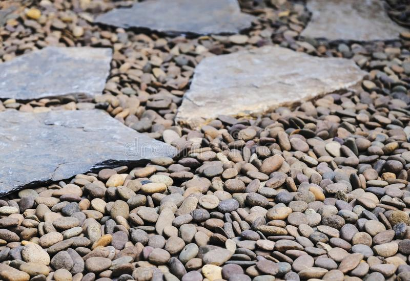 Garden pathway decoration of stone and gravel royalty free stock photos