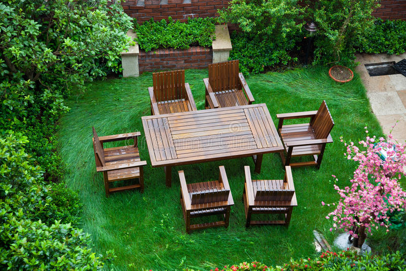Garden Patio. With table and chairs after raining stock photos