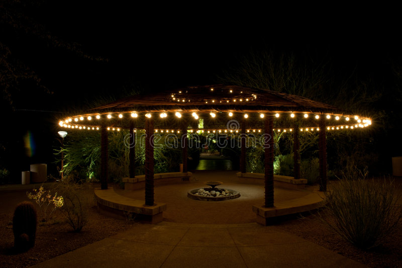 Garden Patio. A beautiful garden patio at night, with a design of a UFO flying saucer stock images
