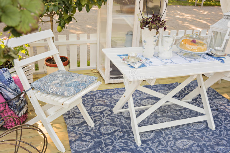 Garden patio furniture. Image of cosy garden patio area royalty free stock photography