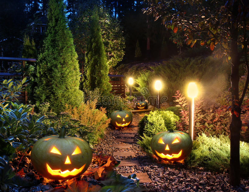 Garden patio with Jack-o-Lanterns. Illuminated home garden path patio lights with halloween pumpkin lanterns stock images