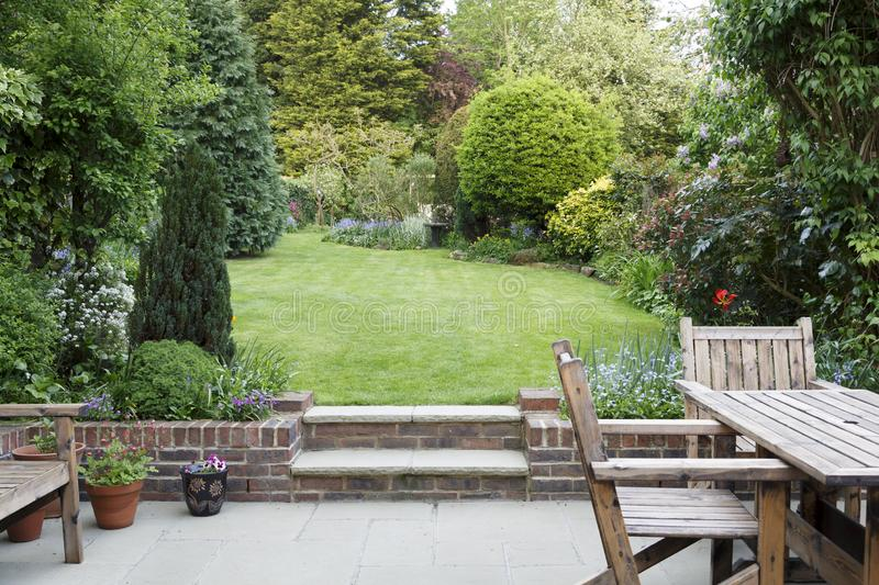 Garden patio and lawn. Garden patio with furniture and lawn in a typical English back garden in London, UK stock photo