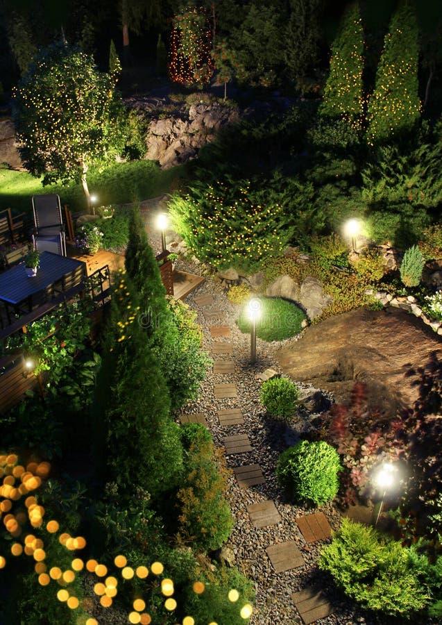 Garden patio party festive illumination in the evening royalty free stock photo