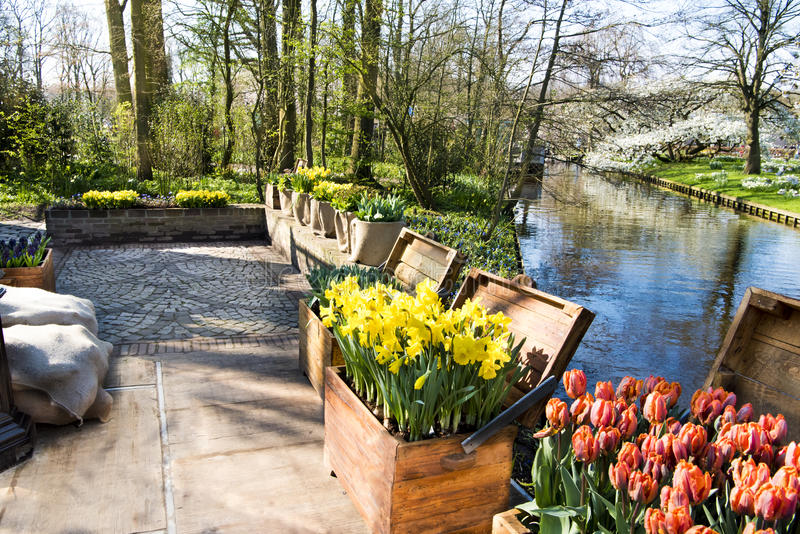 Garden patio, spring flowers, canal royalty free stock images