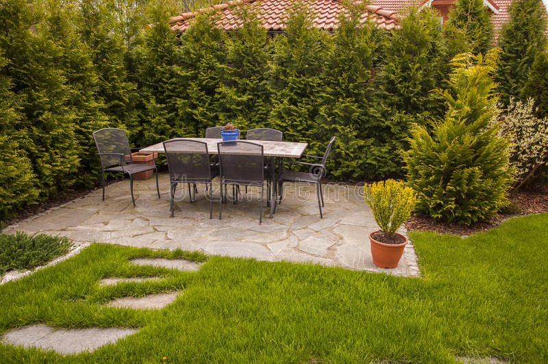 Garden Patio. Garden stone patio with table and chairs stock photography