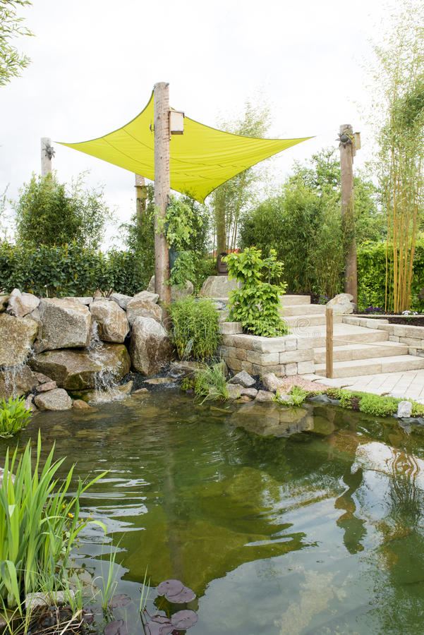 Landscaping with pond royalty free stock photos