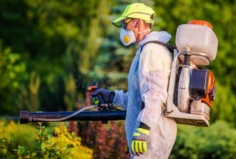 Garden Pest Control Service. S. Men with Gasoline Pest Control Spraying Equipment. Professional Gardening royalty free stock images