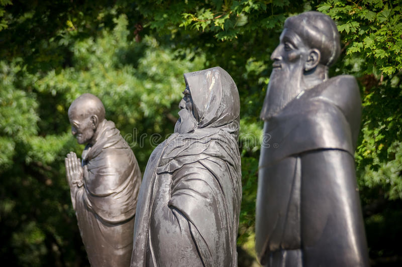 Garden of Philosophy in Budapest, Hungary. Statues of Gandhi, Daruma Taishi and Saint Francis in the Garden of Philosophy in Budapest, Hungary stock photography