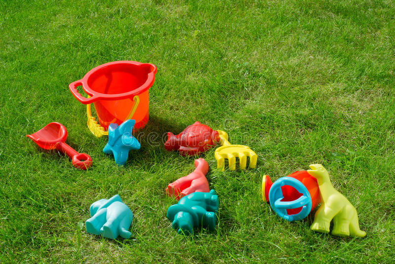 Garden Playtime Fun. Description: An Assortment of childrens toys taken in a garden Location: Corsham, Wiltshire, UK stock photography