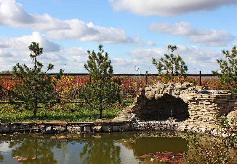 Garden with a pond and a grotto