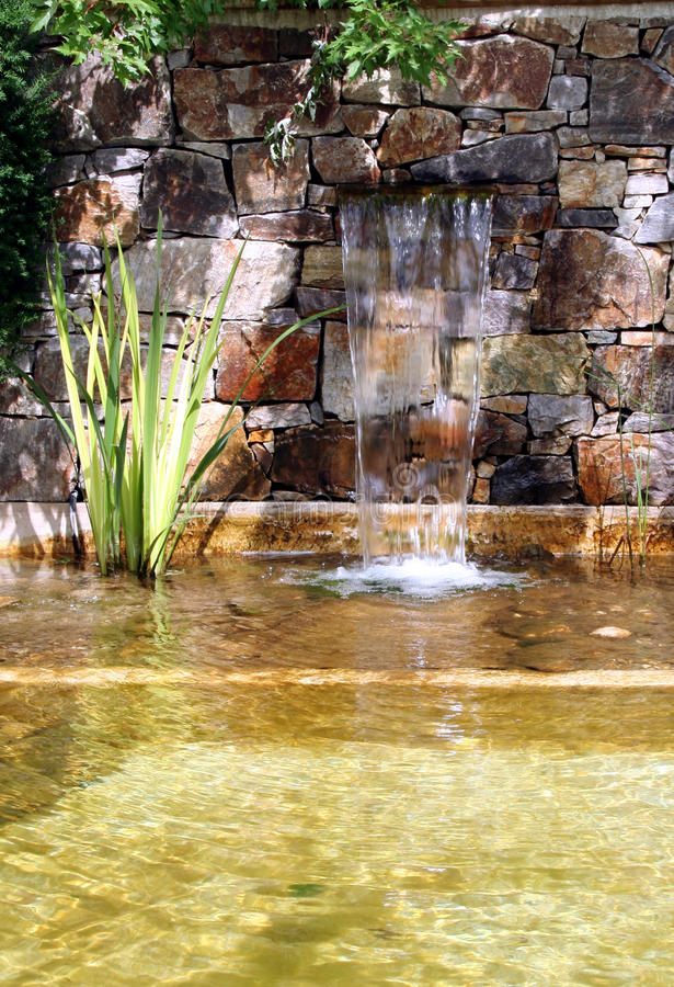 Garden pond with waterfall stock photos