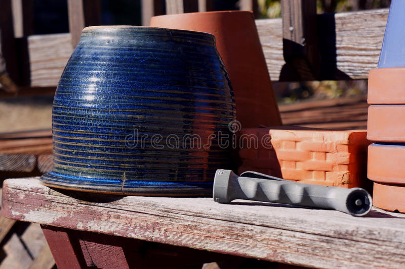 Garden pots await spring plants. Blue patio pots ready for soil, new plants, and warm weather royalty free stock photography