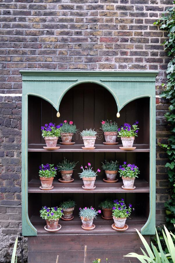 Garden: potted plant display shelves royalty free stock image