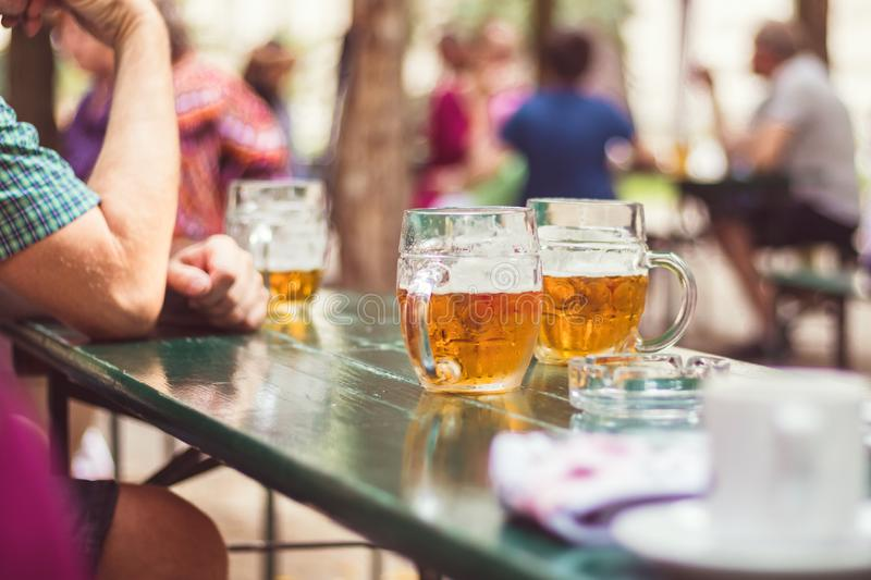 Garden restaurant, glass of beer on table royalty free stock photos