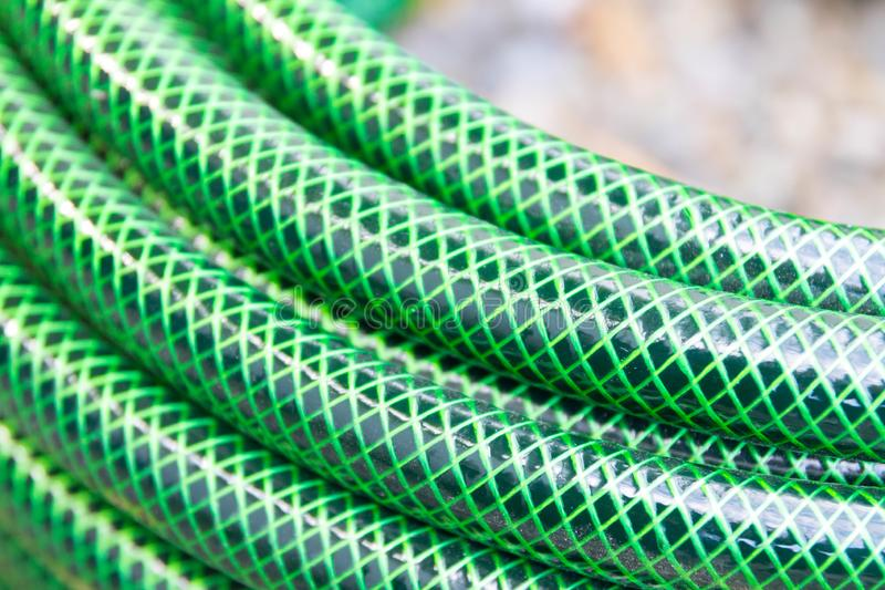 Garden hose pipe green water close up royalty free stock photo