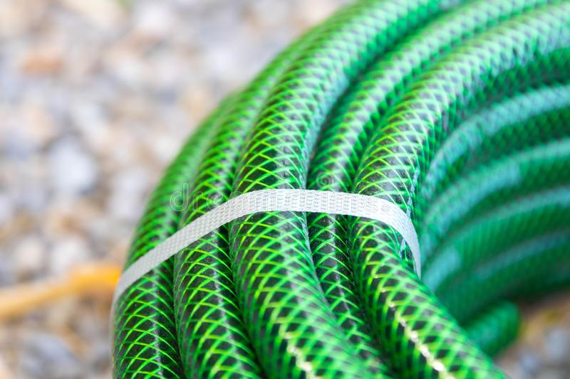 Garden hose pipe green water close up royalty free stock image