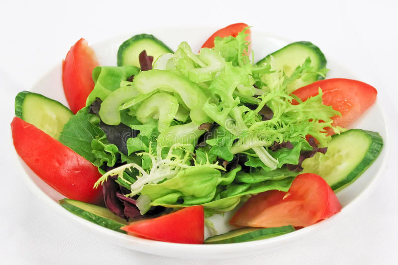 Garden Salad. Fresh assorted green salad with cucumbers and tomatoes royalty free stock photography