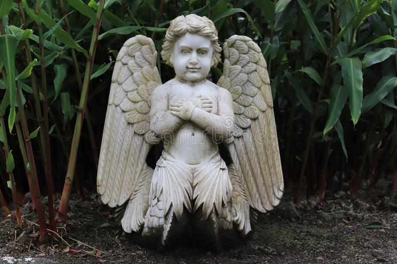 Garden sculpture. Sculpture of an angel. Garden sculpture is an excellent addition for decorating the garden. They give the landscape a special flavor, set it stock photo
