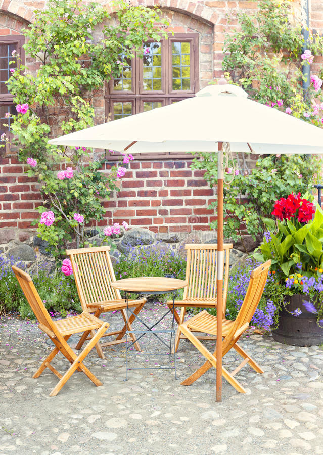 Garden seating area. Image of romantic garden seating area outside period style home or pub/cafe royalty free stock image