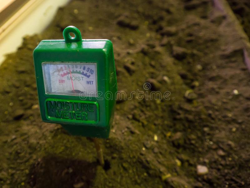 The Garden soil moisture meter avoid to watering your plants more or less. Make your farming and gardening plants easy to care. Garden soil moisture meter avoid stock photos