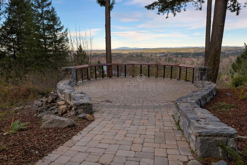 Garden Stone Brick Paver Patio View Deck. Garden Backyard circular brick stone pavers hardscape patio with wood railings stone wall landscaping view deck royalty free stock photography