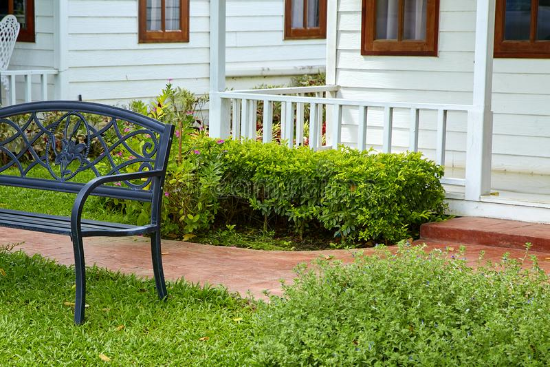 Garden stone path with chair. Front porch of a newer home, Concept Weekend stock images