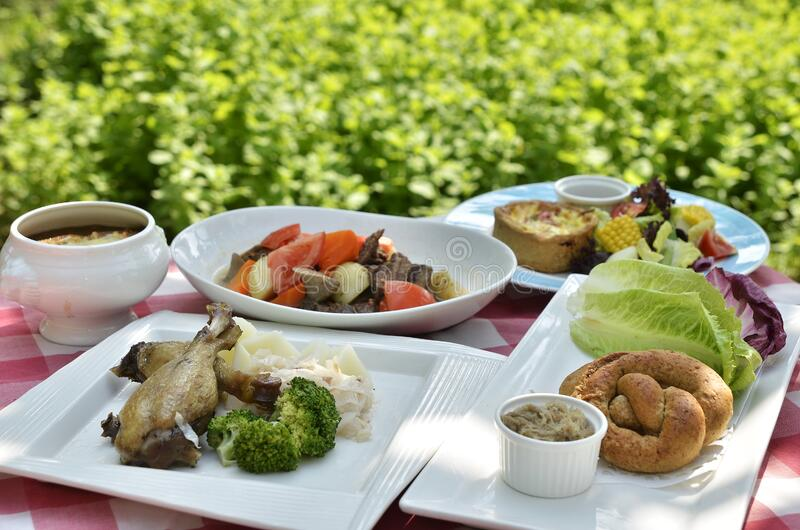 Garden table with food royalty free stock images