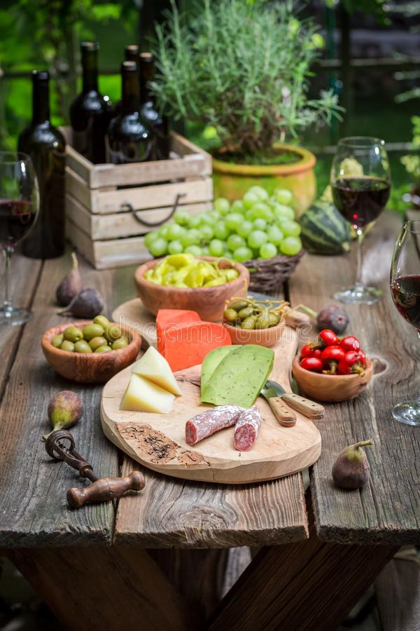 Garden table with wine and fruits in the evening. Session in outside stock photos