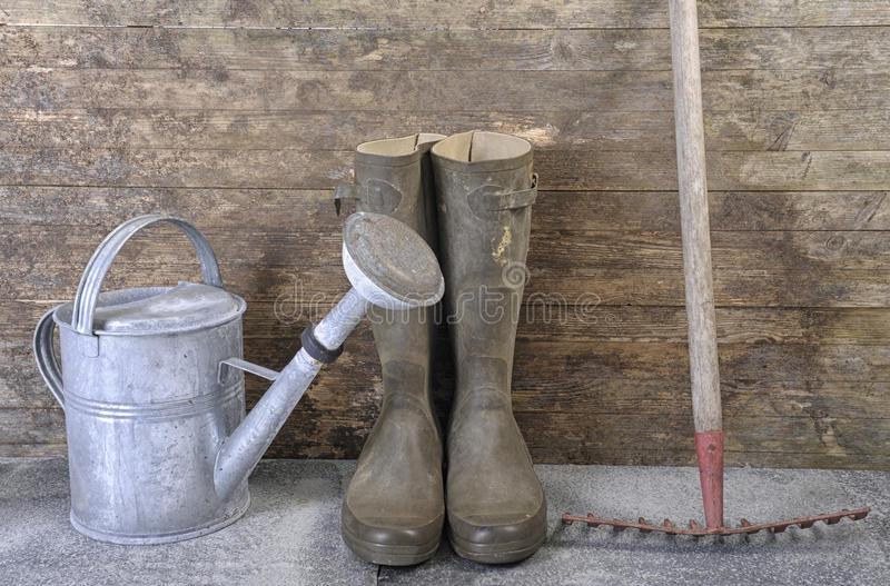 Garden tools. Against old weatherd wooden wall stock photography