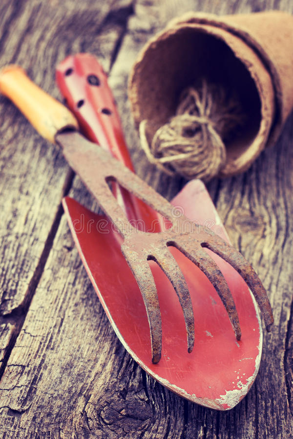 Garden tools. Old garden tools on on a wooden background (Vintage style royalty free stock image